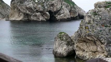 Rock and sea, calm