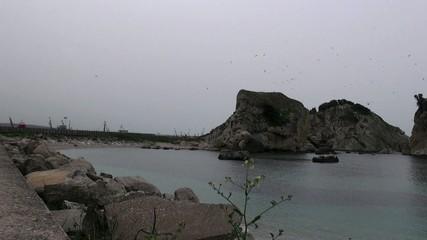 Sea and rocks, calm, gray day, Turkey, Black Sea