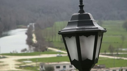 The Victorian streetlight against a rural landscape