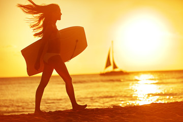 Summer woman body surfer beach fun at sunset