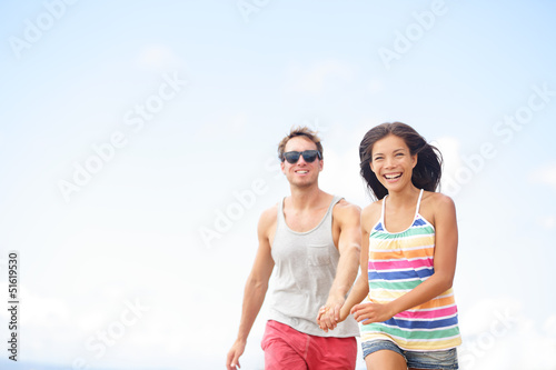 Couple having fun laughing in love outside