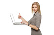 Woman with laptop showing thumb up sign