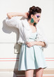 beautiful woman model in white dress posing outdoor