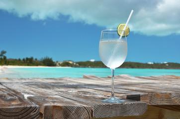 Glass of water against ocean