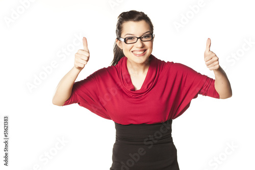 smiling dark-haired girl with blue eyes and glasses shows thumbs
