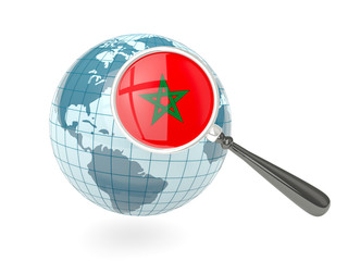Magnified flag of morocco with blue globe