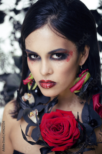 pretty brunette woman with rose jewelry