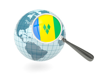 Magnified flag of saint vincent and the grenadines with blue glo