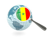 Magnified flag of senegal with blue globe