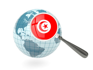 Magnified flag of tunisia with blue globe