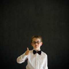 Thumbs up boy dressed up as business man