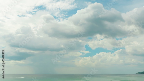Clouds passing through the sky above the sea. Time-lapse.