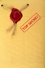 Top secret mail with red stamp and wax seal