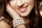 girl with a wide smile. Pearls