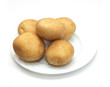 fresh potatoes on the plate on white background