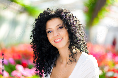 Smiling female florist in a greenhouse