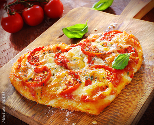 Heart shaped vegetarian pizza