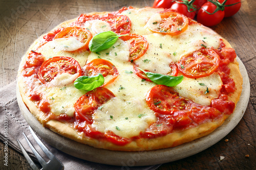 Italian pizza with melted cheese