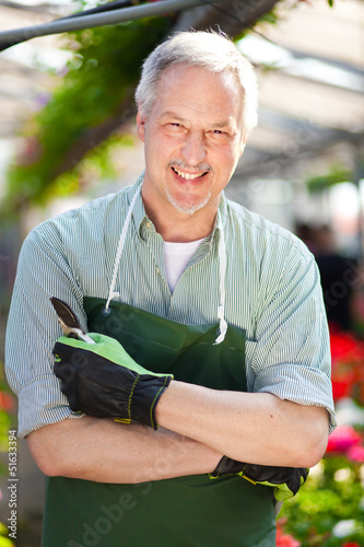 Smiling male florist