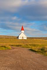 Typical Rural Icelandic Church under a blue summer sky