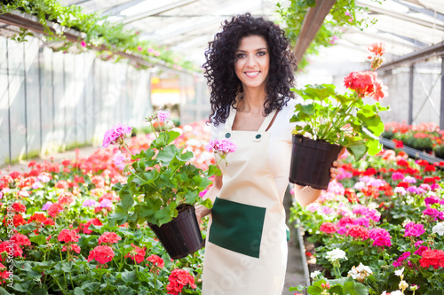 Woman holding flower pots