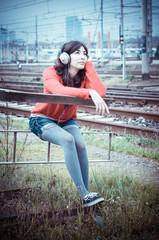 Beautiful stylish woman listening to music