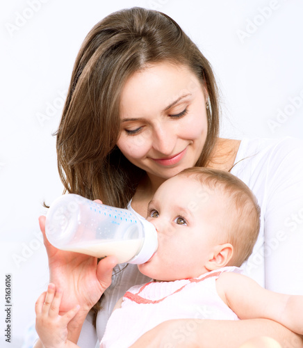 Feeding Baby. Baby eating milk from the bottle