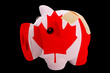 bankrupt piggy rich bank in colors of national flag of canada