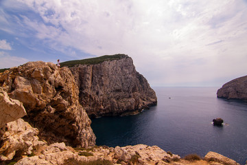 A lone hiker looks out over the view. Sardinia
