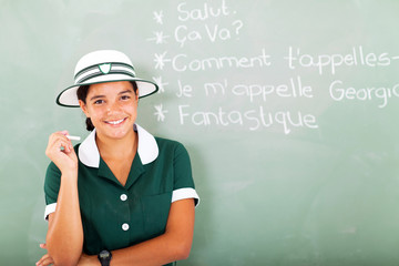 french teen girl holding chalk in classroom