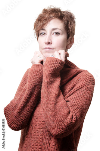 smiling short hair girl cold with orange sweater