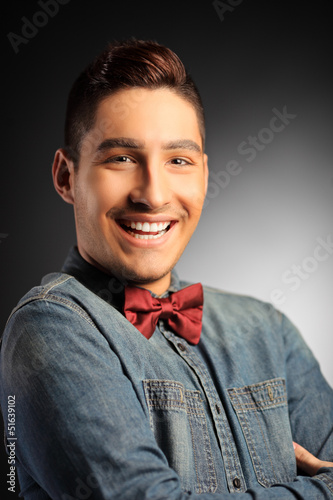 Young smiling male looking at camera
