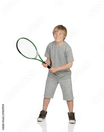 Preteen playing tennis holding racket