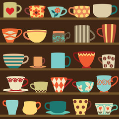 Colorful retro cups on shelves