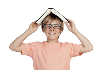 Preteen boy with a book and glasses
