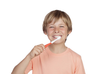 Smiling boy brushing his teeth