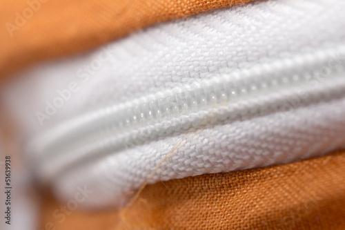 lock on white fabric. macro