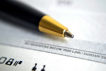 Close up on cheque with a pen