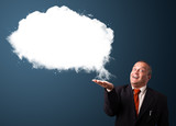Crazy businessman presenting abstract cloud copy space