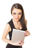 Gorgeous woman in black dress holding digital tablet