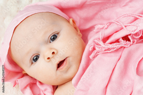 Baby girl in pink scarf