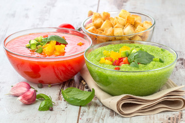Delicious cold red and green gazpacho soup with garlic croutons