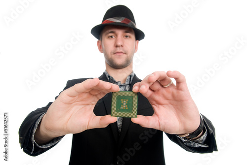 The man in the hat showing a microchip computer