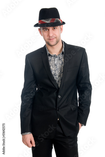Handsome man in a hat on a white background