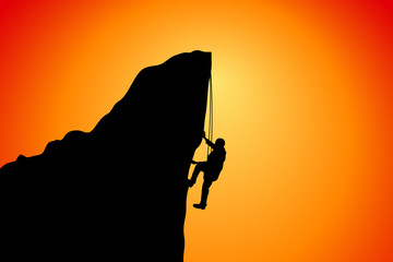 silhouette of a man at the cliff of the mountain