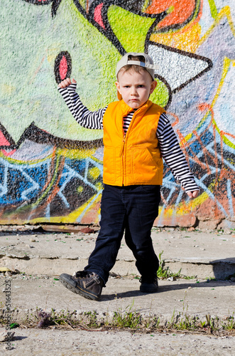 Adorable little boy striking a dance pose