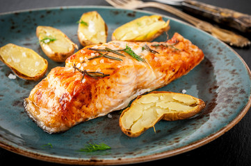 Grilled salmon and roasted potatoes with herbs