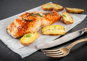 Grilled salmon and baked potatoes