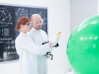 people scanning objects in laboratory