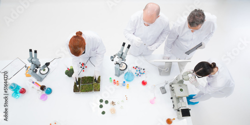bird-eye of teachers people in a chemistry lab supervising